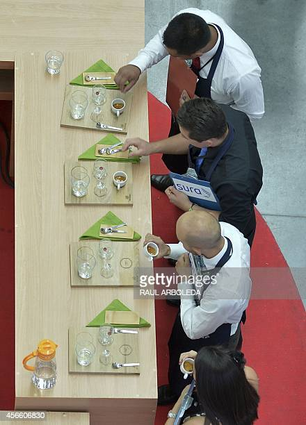 Judges taste coffee during the IX National Baristas Championship in the framework of the Colombian coffee Expoespeciales Cafe de Colombia fair in...
