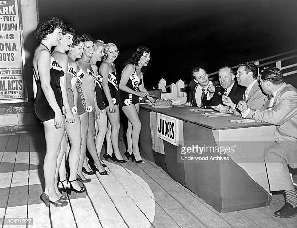 Judges tasting the baking of the seven finalists in the Mrs New Jersey contest Palisades Park New Jersey 1953 Judges are Bobby Sherwood band leader...