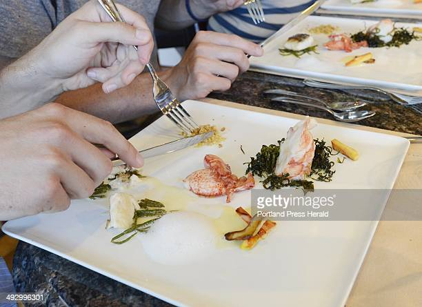 Judges try a dish prepared by Chef Steve Corry of Five FiftyFive restaurant in Portland during the Shucks Maine Lobster Chef World Series at Corry's...