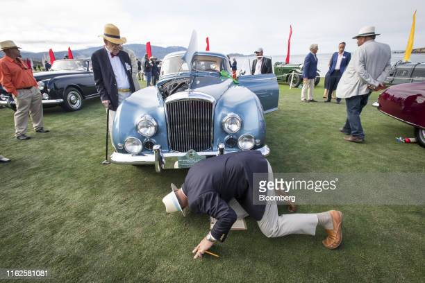 Judges view a 1954 Bentley Motors Ltd. R-Type Continental H.J. Mulliner Fastback during the 2019 Pebble Beach Concours d'Elegance in Pebble Beach,...