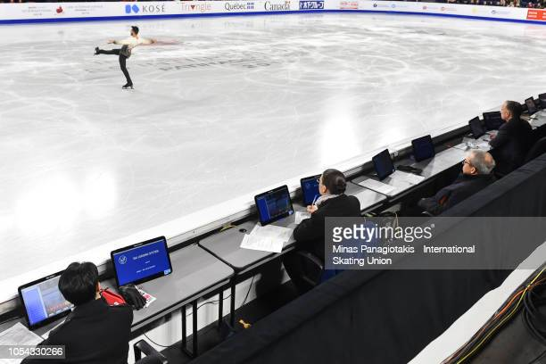 Judges watch as Kevin Aymoz of France performs his routine on day two during the ISU Grand Prix of Figure Skating Skate Canada International at Place...