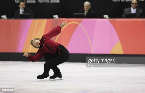 Judges watch Jeffrey Buttle of Canada compete in the Men's Free Skate Program Final during Day 6 of the Turin 2006 Winter Olympic Games on February...