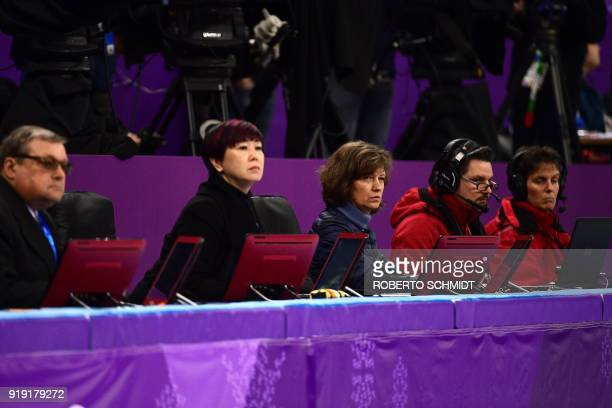 Judges watch the men's single skating free skating of the figure skating event during the Pyeongchang 2018 Winter Olympic Games at the Gangneung Ice...