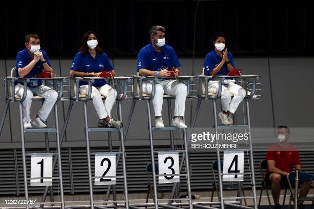 Judges wearing face masks wait for the start of the men's 3m springboard final at the FINA Diving World Cup and test event for the Tokyo 2020 Olympic...