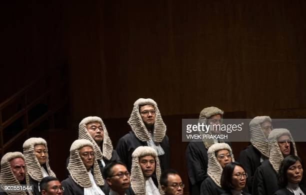 Judges wearing robes and horsehair wigs attend a ceremony held to mark the opening of the legal year in Hong Kong on January 8 2018 Hong Kong's new...