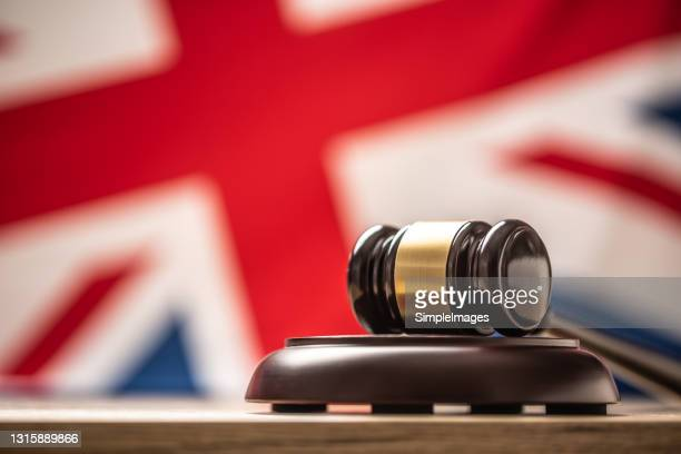 judges wooden hammer in front uk flag. - judge stock pictures, royalty-free photos & images