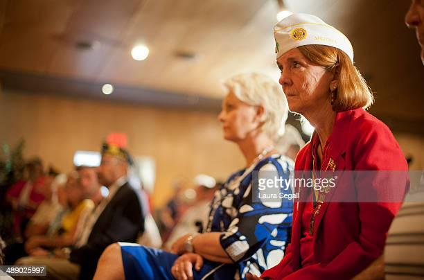 Judi Beischel listens as Sen John McCain speaks at a forum at the Burton Barr Central Library on May 9 2014 in Phoenix Arizona Sen John McCain met...