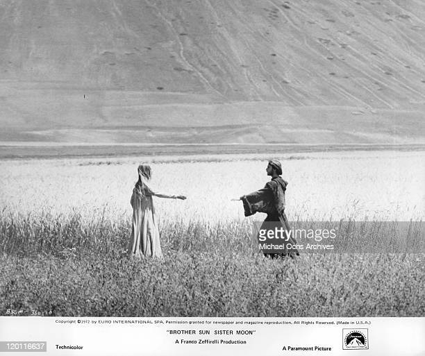 Judi Bowker and Graham Faulkner join hands in a scene from the film 'Brother Sun and Sister Moon' 1972