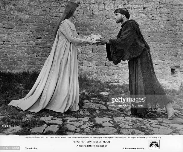 Judi Bowker offers a loaf of bread to Graham Faulkner in a scene from the film 'Brother Sun and Sister Moon' 1972