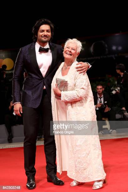 Judi Dench and Ali Fazal walk the red carpet ahead of the 'Victoria Abdul' screening during the 74th Venice Film Festival at Sala Grande on September...