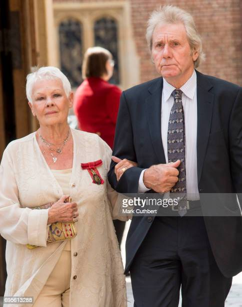 Judi Dench and David Mills attend Evensong in celebration of the centenary of the Order of the Companions of Honour at Hampton Court Palace on June...