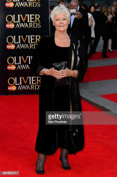Judi Dench attends the Laurence Olivier Awards at The Royal Opera House on April 13 2014 in London England