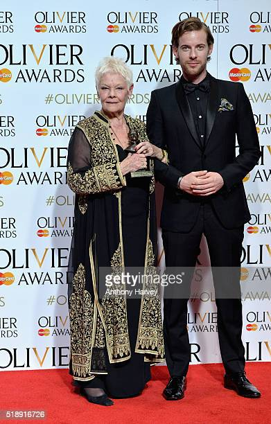 Judi Dench winner of the award for Best Actress in a Supporting Role for ' The Winter's Tale' and Luke Treadaway pose in the winners room at The...