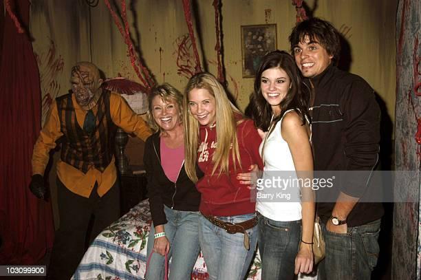 Judi Evans Ashley Benson Rachel Melvin and Darin Brooks in the 13 Axe Murder Manor Maze