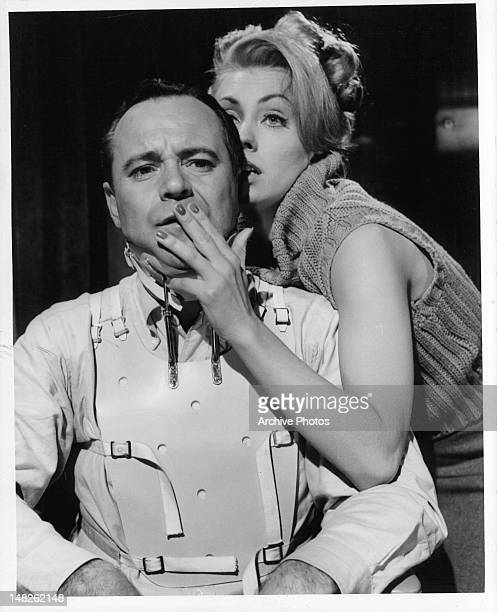 Judi West puts her hand over the mouth of Jack Lemmon in a scene from the film 'The Fortune Cookie' 1966