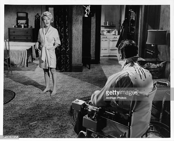 Judi West wearing bathrobe standing in front of Jack Lemmon in a scene from the film 'The Fortune Cookie' 1966