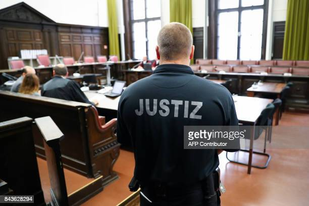 A judicial officer stands in a court room ahead the beginning of the trial against alleged Turkish spy Mehmet S in Hamburg northern Germany on...