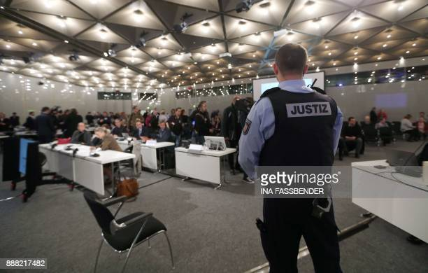 Judicial officer stands in the courtroom on the fairground in Duesseldorf, western Germany, on December 8, 2017 ahead the beginning of the trial...