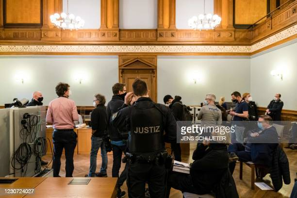 Judicial officer wearing a protective face mask and media representatives wait for the beginning of the trial of defendant Andreas Philipp S. , a...
