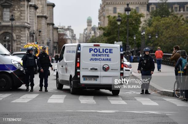 A judicial police vehicle drives toward Paris prefecture de police after three persons have been hurt in a knife attack on October 3 2019 A knife...
