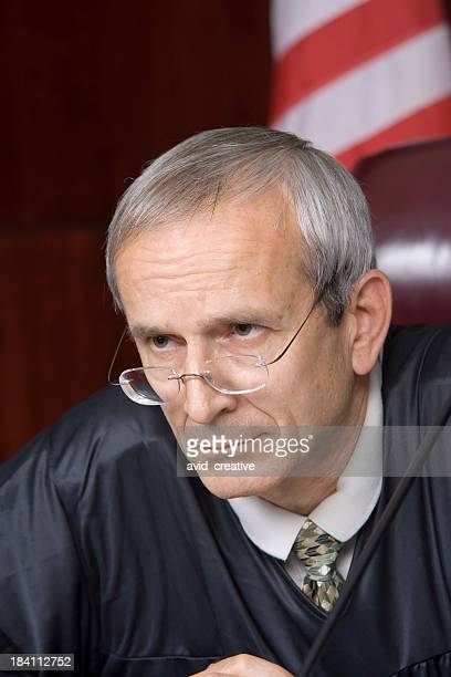 us judicial system-stern judge portrait - religious occupation stock pictures, royalty-free photos & images
