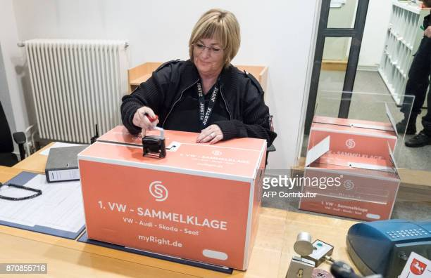 A judiciary employee places an entry stamp on a box with documents of around 15000 owners of cars from the Volkswagen group participating in a class...