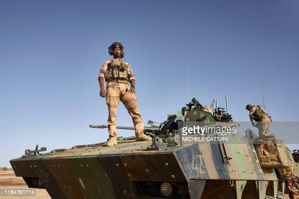 TOPSHOT Judickael a driver poses for a portrait on an Armoured Personnel Carrier of the French Army during the Barkhane operation in northern Burkina...