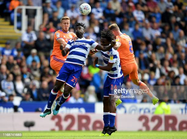 Judilson Gomes and Ovie Ejaria of Reading compete with Joe Ralls and Will Vauks of Cardiff City for the ball during the Sky Bet Championship match...