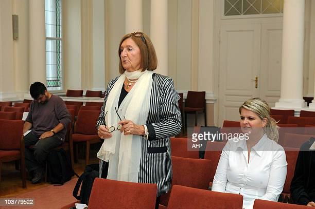 Judit Majlath sister of murdered Briton Eva Rhodes responds to a judge's question during the first day of the trial of the person accused of killing...