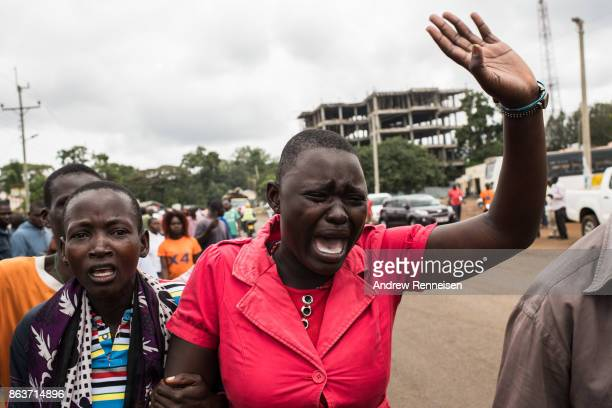 Judith Achieve Omondi cries during the funeral of her husband Stephen Omondi Oduor who was one of three men killed by the police in an opposition...