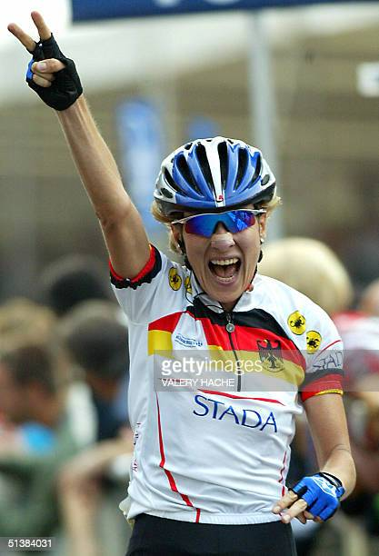 Judith Arndt of Germany jubilates after she crossed the line t win the elite women's road race of the 2004 UCI road world championships 02 October...