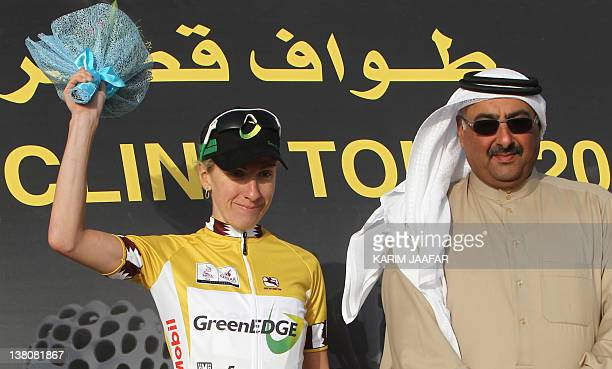 Judith Arndt of Germany poses on the podium with Sheikh Khalid Bin Ali Al-Thani head of Qatar Cycling Fedration after receiving the leader's gold...