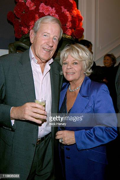 Judith Chalmers and husband Neil Durden-Smith during Remy Martin / Theo Fennell Hot Ice Party - Inside at 25 Belgrave Square in London, Great Britain.