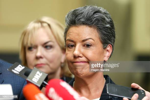 Judith Collins and deputy leader Paula Bennett look on while Leader Simon Bridges speaks to media after a caucus meeting at Parliament on October 16...