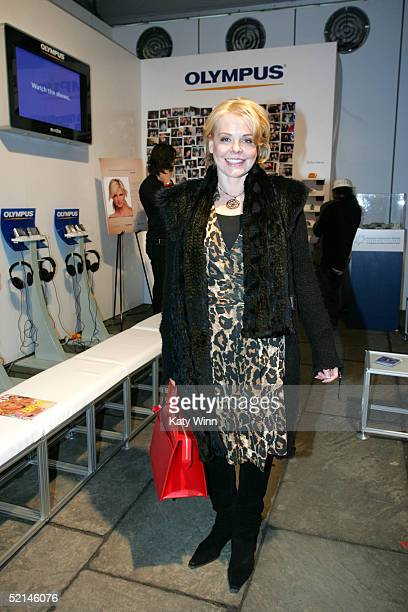 Judith Czelusniak from Bloomberg News poses for photos in the front of the lobby during Olympus Fashion Week Fall 2005 at Bryant Park February 6,...