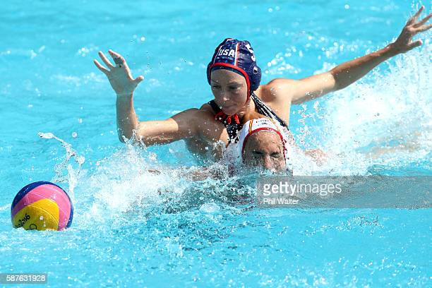 Judith Forca Ariza of Spain and Kk Clark of the United States contest the ball during the Preliminary Round Group B Womens Waterpolo match between...
