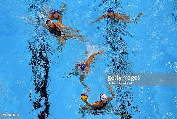 Judith Forca Ariza of Spain looks to pass the ball during the Women's Water Polo match between Spain and China at Olympic Aquatics Stadium on August...