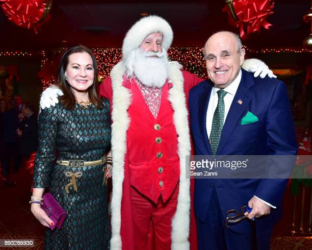 Judith Giuliani Santa Claus and Rudy Giuliani attend A Christmas Cheer Holiday Party 2017 Hosted by George Farias and Anne and Jay McInerney at The...