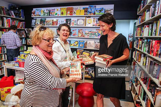 Judith Grant Williams and Caroline Morgan Di Giovanni get Alice Munro newest novel Dear Life from Type books' Joanne Saul at their Spadina Rd store...