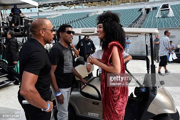 Judith Hill and Kenneth Babyface Edmonds talk backstage during the 2016 Cincinnati Music Festival at Paul Brown Stadium on July 22 2016 in Cincinnati...
