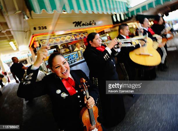 Judith Merillo Esmeralda Garcia Guillermo Nunez Mariana Nanez and Ileana Garcia members of the allfemale strolling Mariachi band Ellas Son perform at...