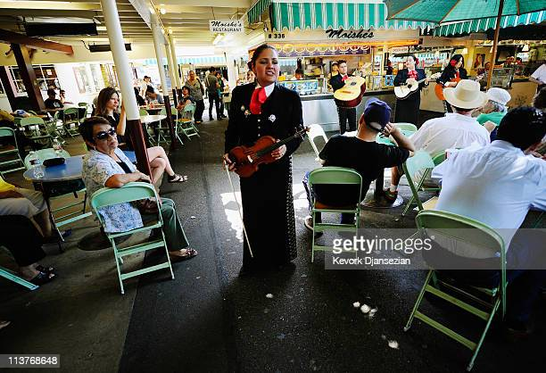 Judith Merillo violinist of the allfemale strolling Mariachi band Ellas Son perform at Los Angeles Farmer Market during Cinco de Mayo festivities on...