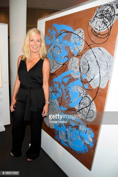 Judith Milberg infront of her paintings during her exhibition opening 'Judith Milberg Aus der Mitte' at HypoVereinsbank Charlottenburg on July 18...