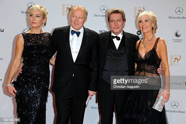 Judith Milberg with Axel Milberg and Jan Fedder with Marion Fedder attend the Red Carpet for the Bambi Award 2011 ceremony at the RheinMainHallen on...