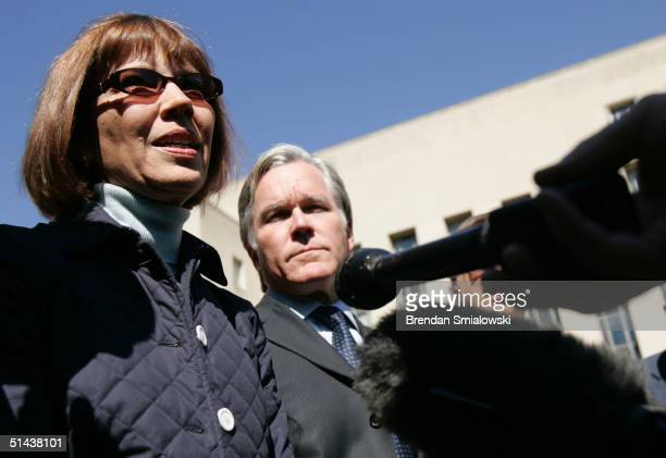 Judith Miller a New York Times reporter speaks with the press while Bill Keller Executive Editor of the New York Times listens outside the E Barrett...
