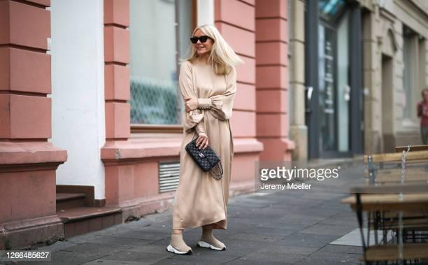 Judith Mosqueira do Amaral wearing Balenciaga sneaker, Ariane Ernst earring, by Aylin Koenig dress, Saint Laurent shades and Chanel bag on August 14,...