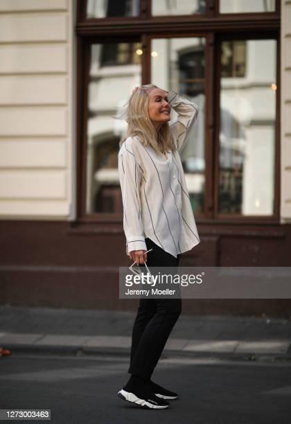 Judith Mosqueira do Amaral wearing Balenciaga sneaker Zara pants Celine shades and Seidenstinker shirt on September 15 2020 in Cologne Germany