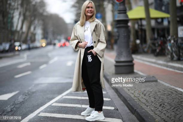 Judith Mosqueira do Amaral wearing Burberry pants and shirt, Weekend Max Mara coat and Copenhagen Studios sneaker on March 06, 2020 in Cologne,...
