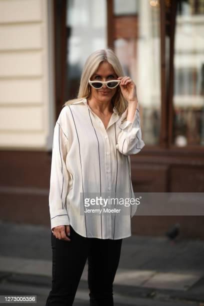 Judith Mosqueira do Amaral wearing Zara pants Celine shades and Seidenstinker shirt on September 15 2020 in Cologne Germany