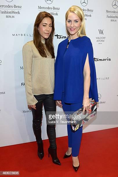 Judith Rakers and Angela Gessmann attend the Laurel show during MercedesBenz Fashion Week Autumn/Winter 2014/15 at Brandenburg Gate on January 16...